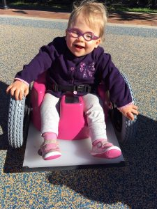 Ms. Natalie rocking her rad Bumbo chair wheels